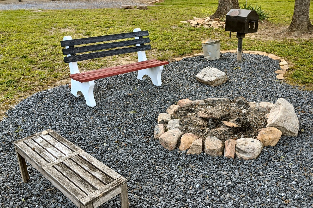 Campfire area with eating, picnic table and park-style grill