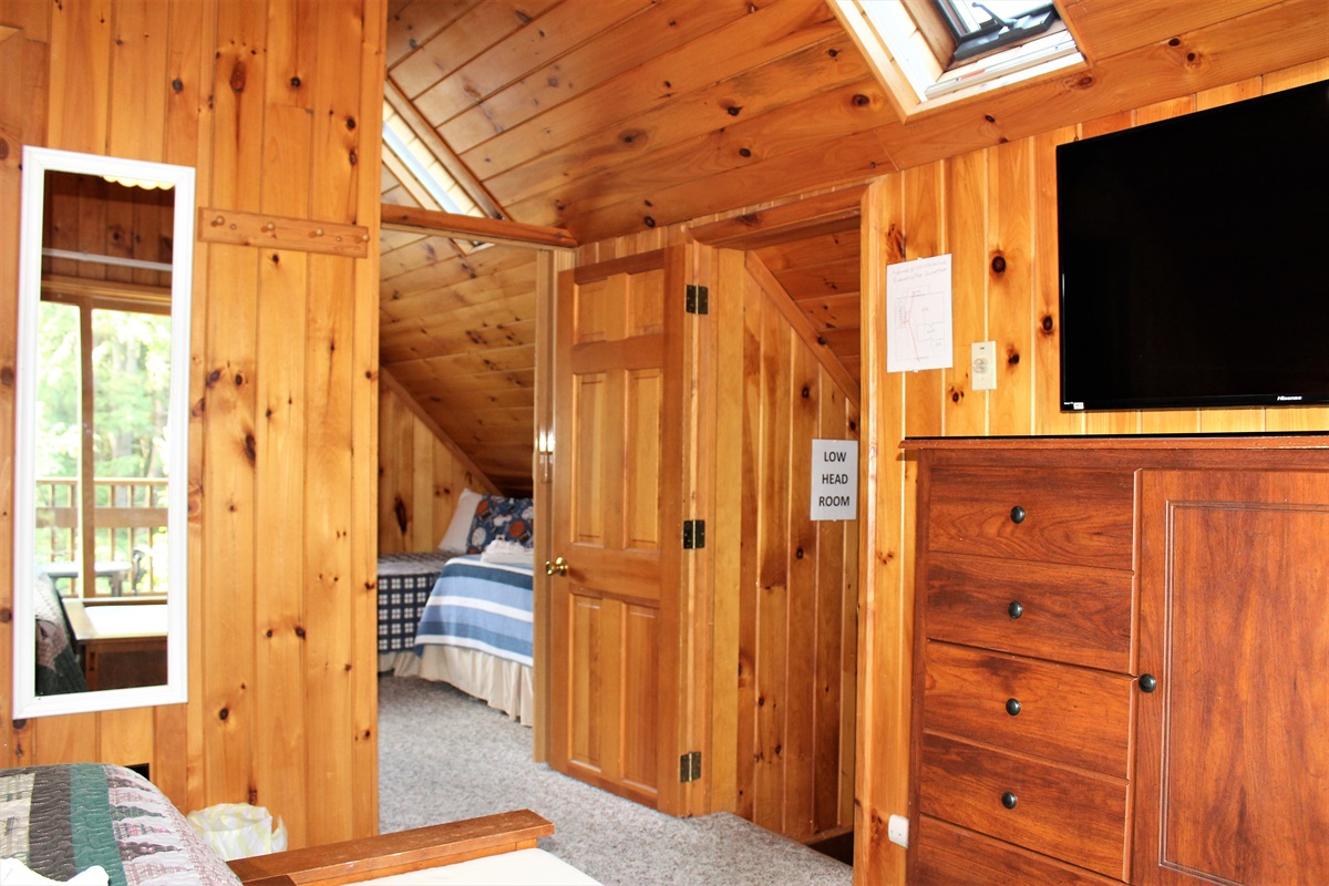 King and twin bedrooms shown with the folding door between the rooms open