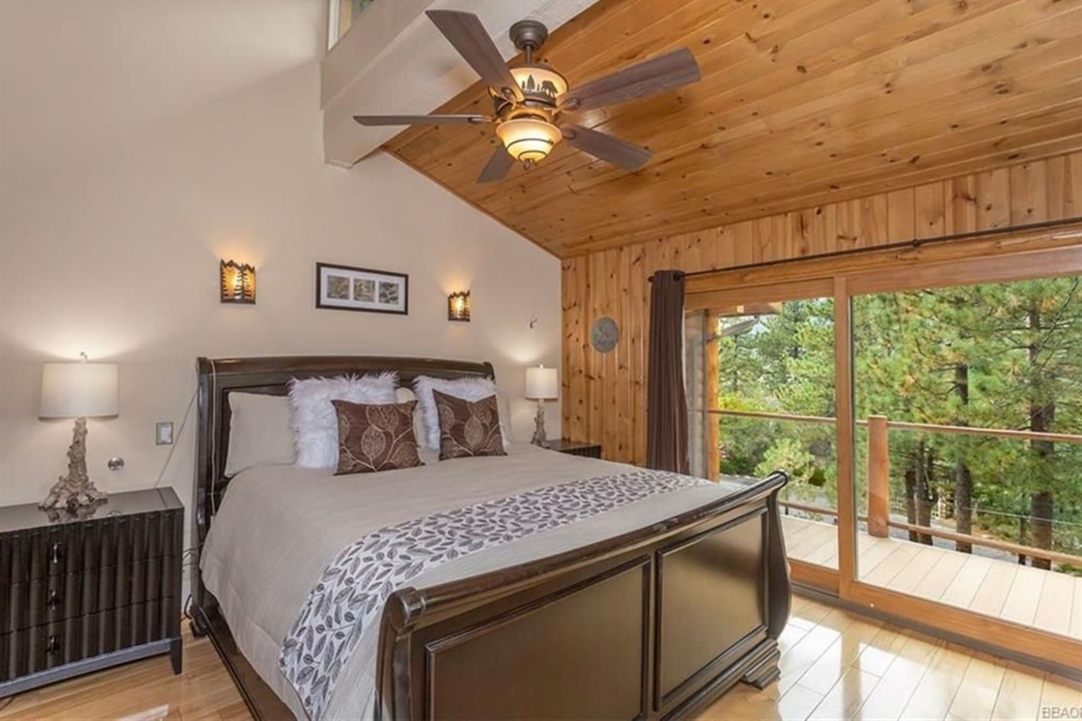Bedroom #2: It has 1 queen bed, access to deck, beautiful views, and ensuite bathroom.