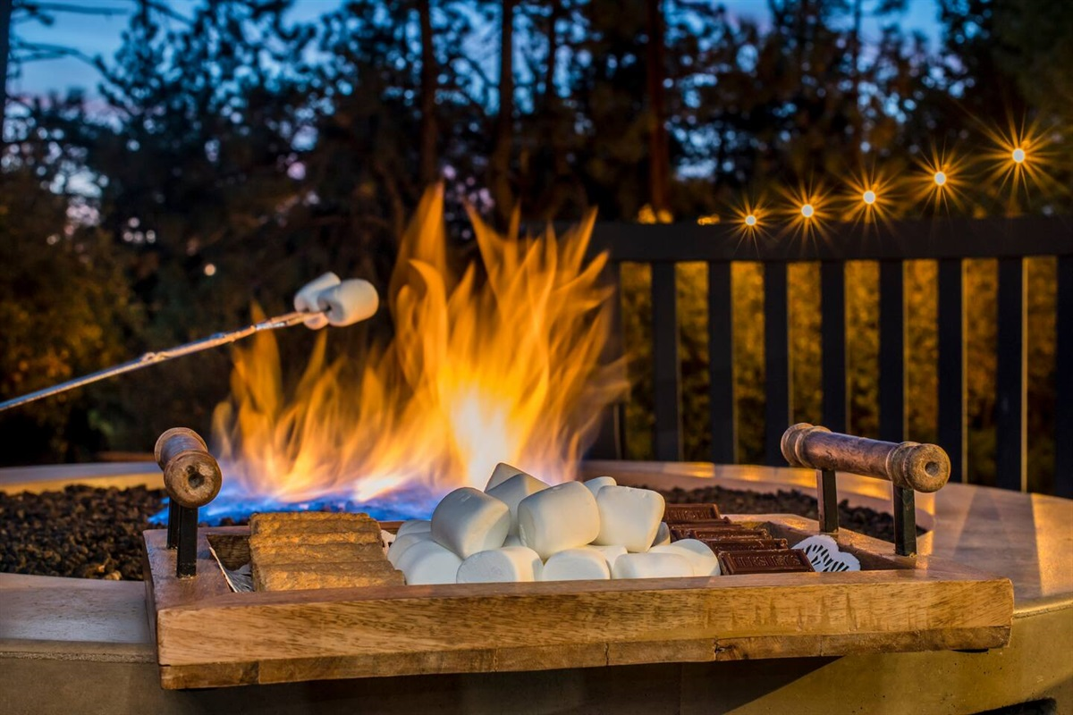 Roast some marshmallows over the fire pit and enjoy gorgeous mountain views from the back deck of Fox Haus. More s'mores? Yes, please!