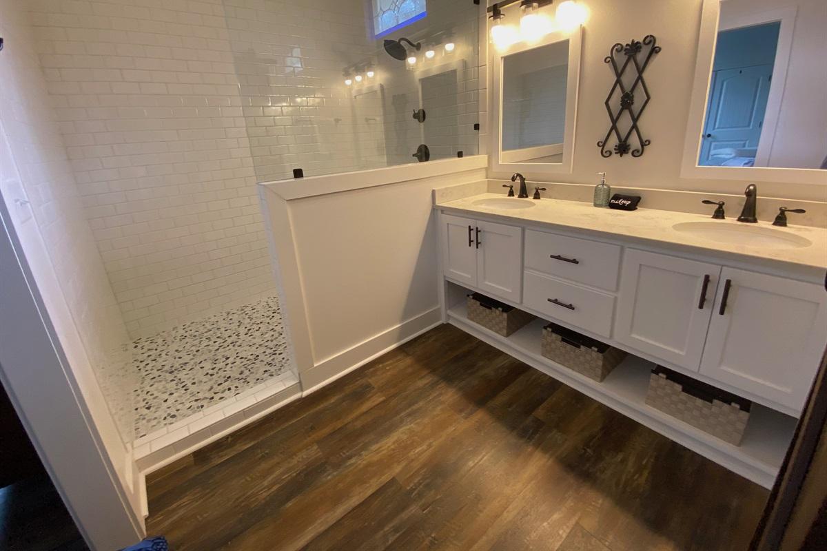 Master En-Suite Bathroom with Huge Walk-In Shower and Double Vanity.