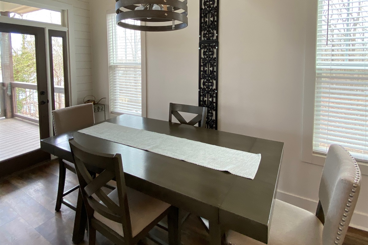 The Antique Gates used here as support for extra lighting over the Dining Room Table.