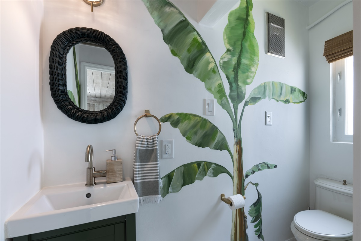 2nd Bathroom off the living room area with a shower and hand-painted palms.
