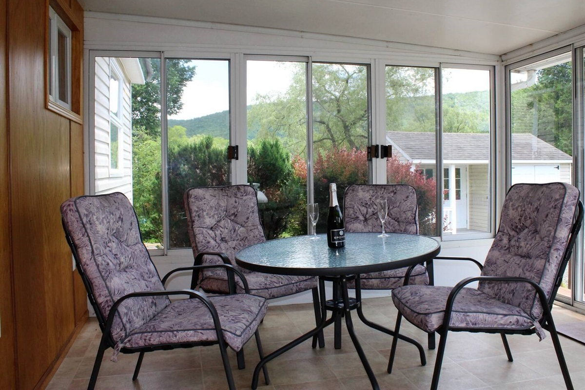 Relax with an evening cocktail on the 3-season sunporch