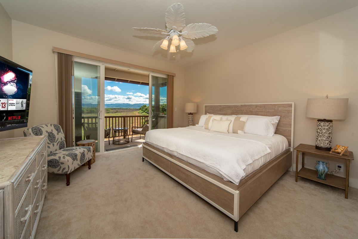 2nd-floor master bedroom with king bed, ensuite, and balcony