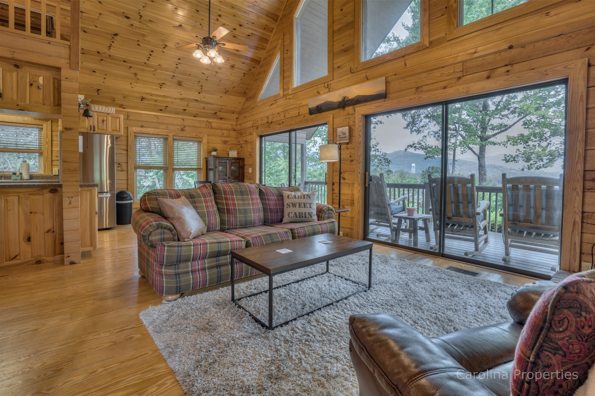 Comfortable seating in the living room with a view of the mountains