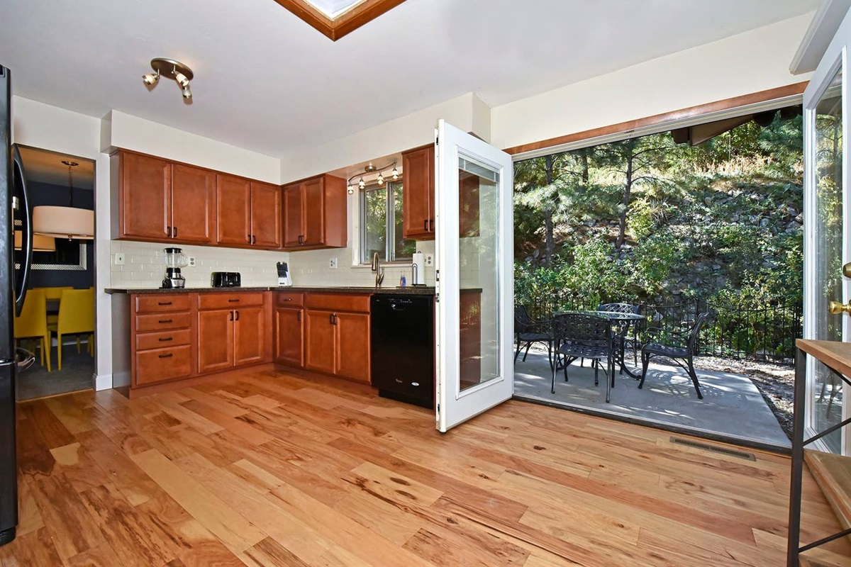 Walk from the kitchen and coffee bar right to the beautiful and private patio.
