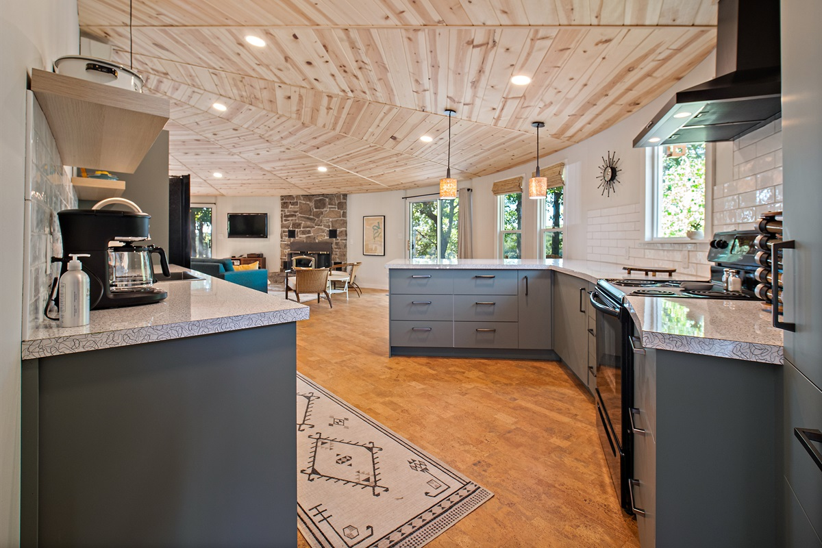 This gorgeous kitchen is open to the dining and living areas, and the views can't be beat.