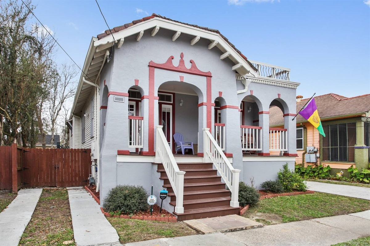 Large front porch. Dual driveways fit up to 3 vehicles, plus free off street parking.