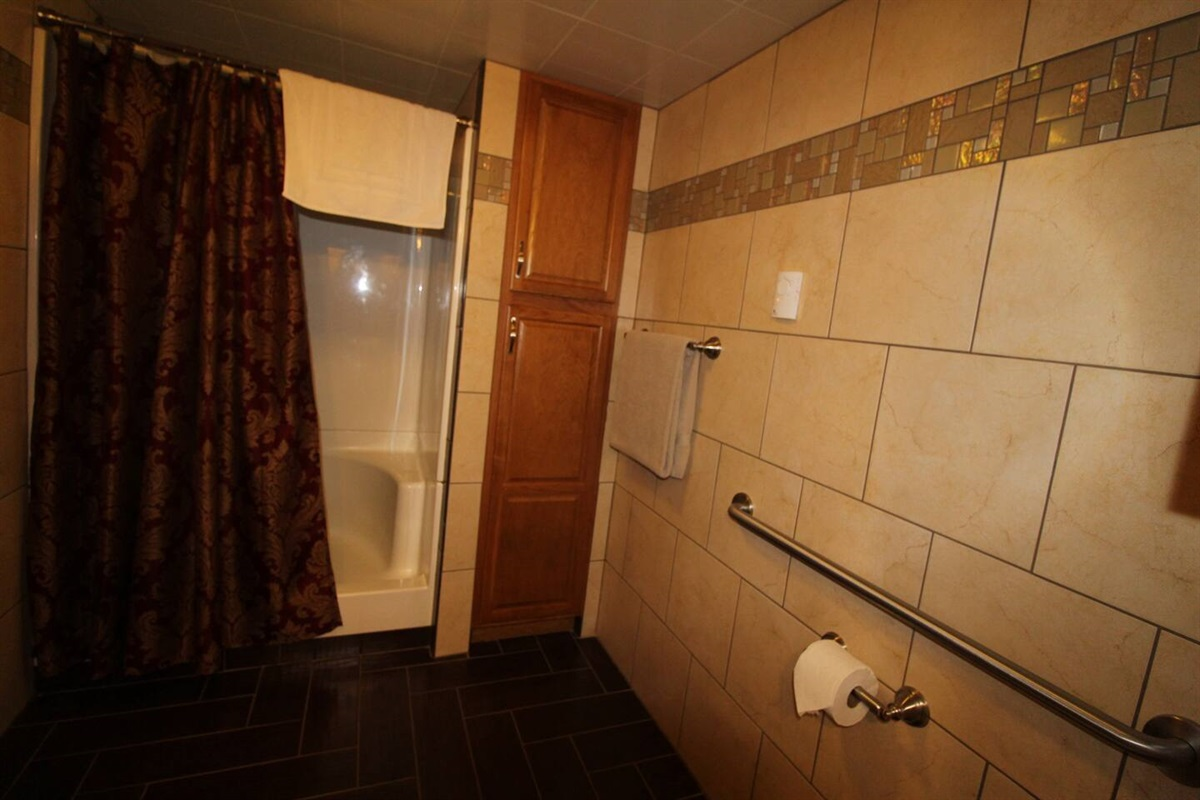 Fully tiled bath with full size shower and heated bathroom floors
