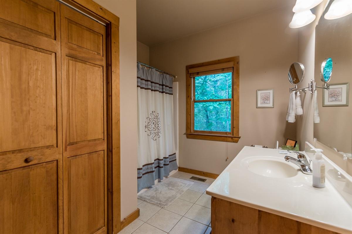 Main Floor Full Bath (Laundry Area in Closet)