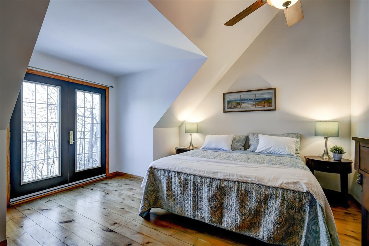 Master bedroom w/Juliet Lakeview balcony. King top of the line pillow top mattress for a perfect nights rest!