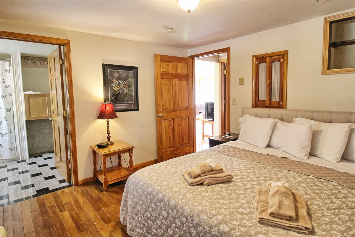 Bedroom #1 with King bed and en suite handicapped accessible bath