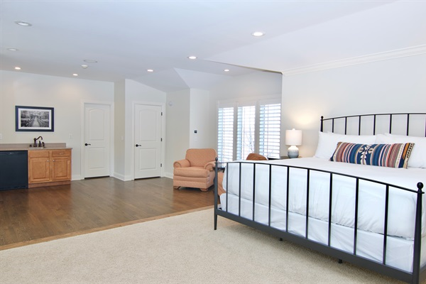 Guests desiring extra privacy will love the 4th floor suite with king bed, TV, ensuite bath and refrigerator