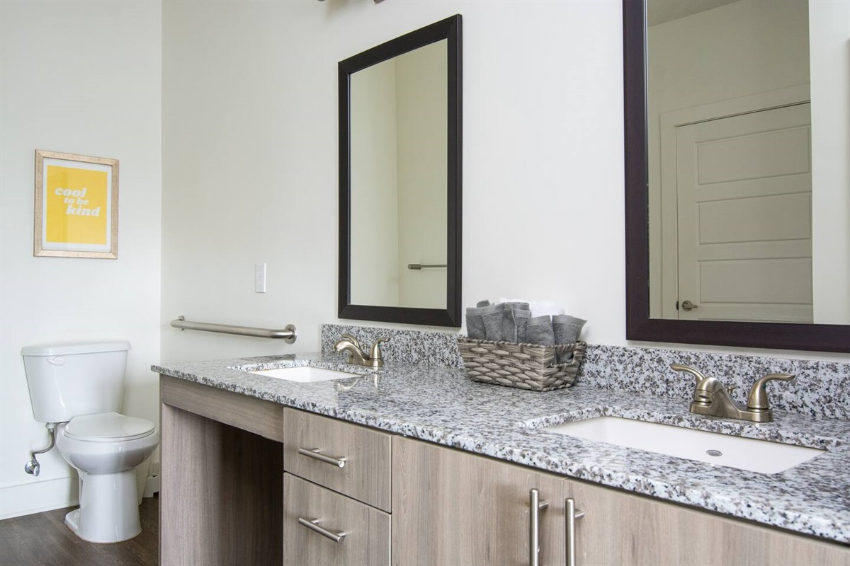 Clean bathroom with new amenities, (his + hers sinks) shampoo/conditioner/body wash and plenty of fresh towels!