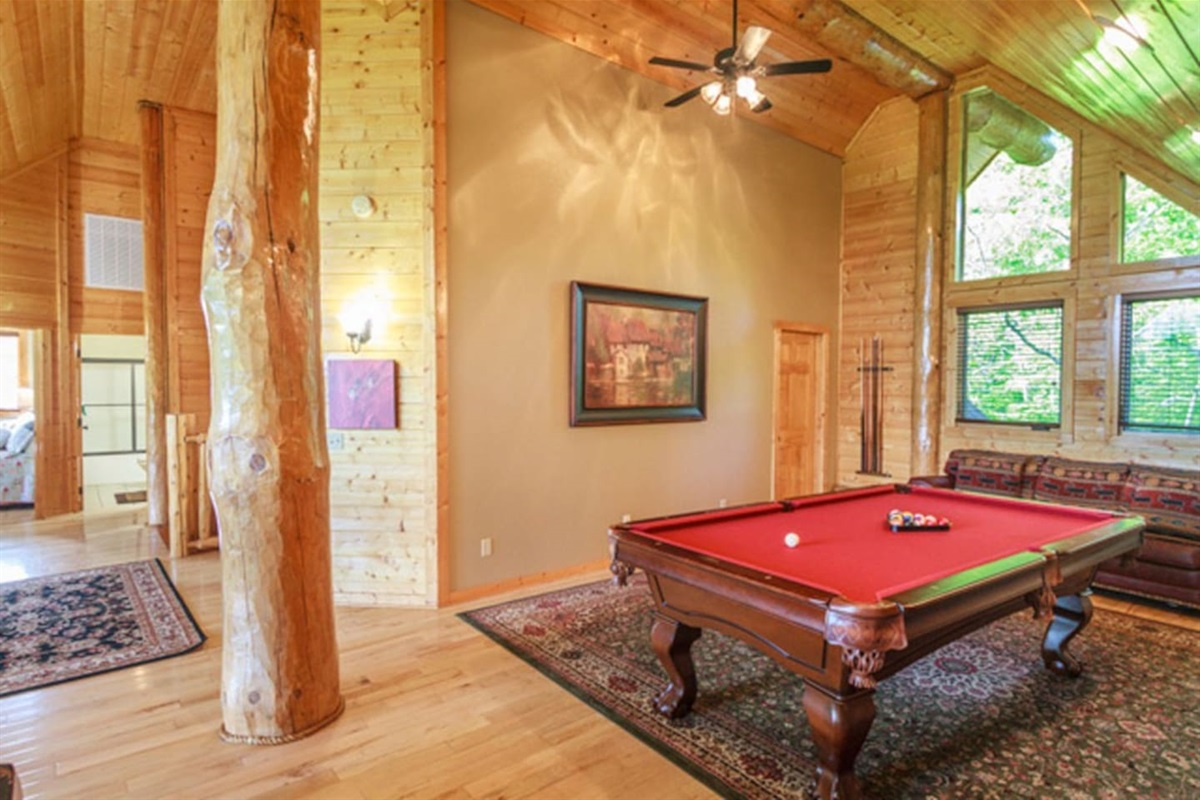 Pool table, TV, and sofas upstairs for entertainment and relaxing.