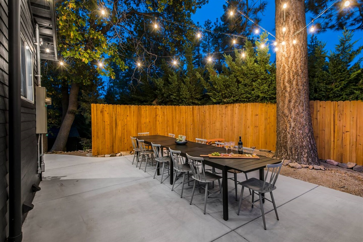 Charmingly rustic and private back deck with outdoor dining table for fun family meals and get-togethers with friends.