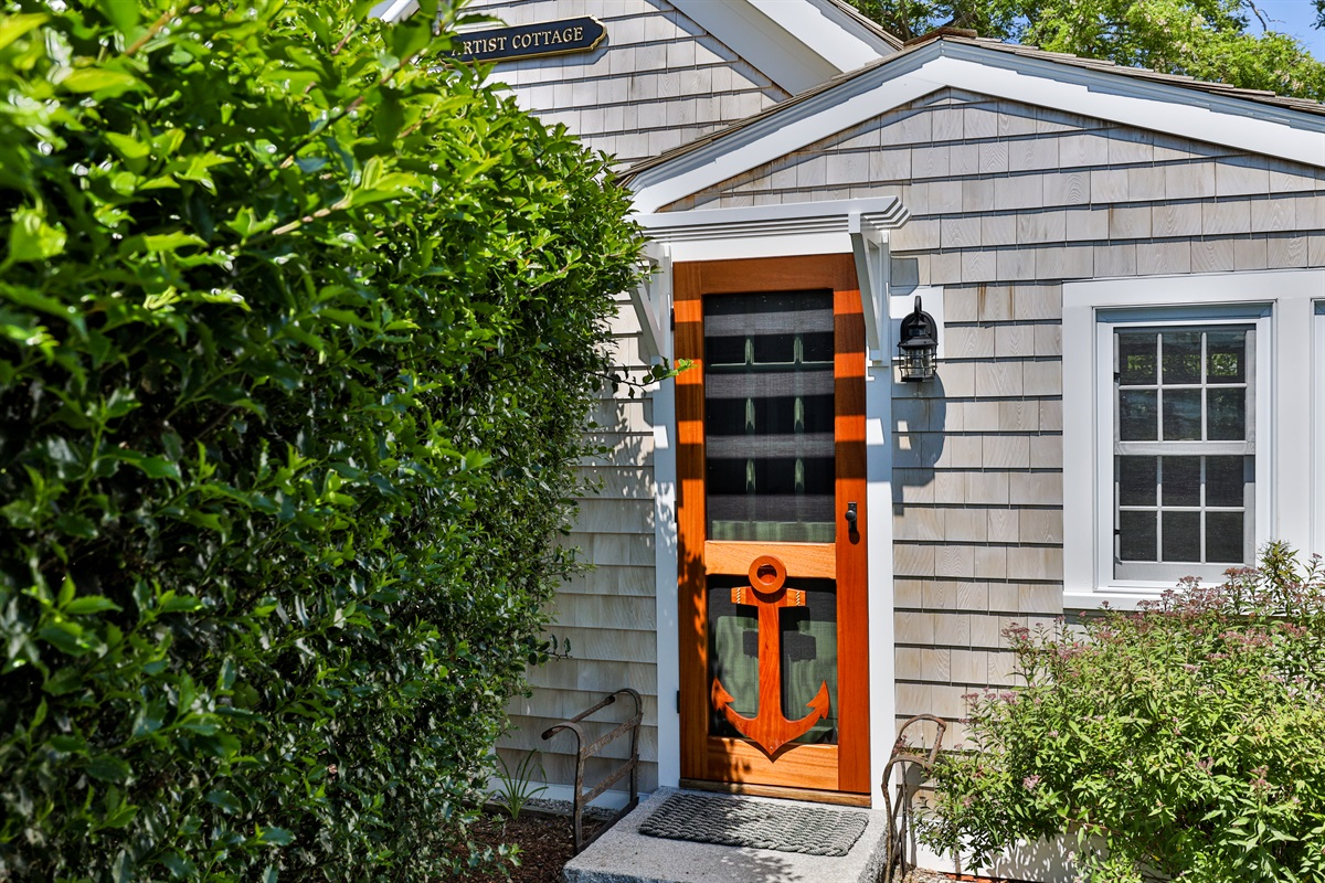 This charming cottage has its own private entrance and is surrounded by immaculate professionally landscaped grounds. A small pergola sits atop the front entry and a custom mahogany storm d