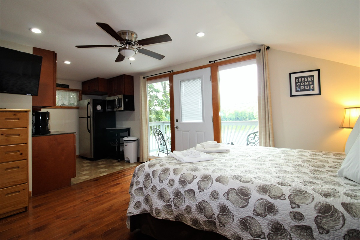 Bedroom #5 with private balcony overlooking the lake