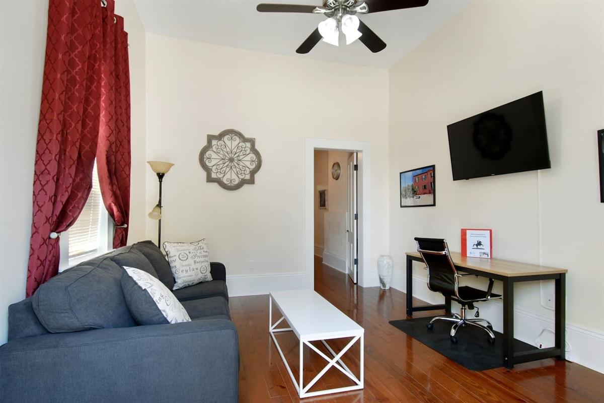 """Living room. 50"""" smart tv, queen sleeper sofa, desk."""