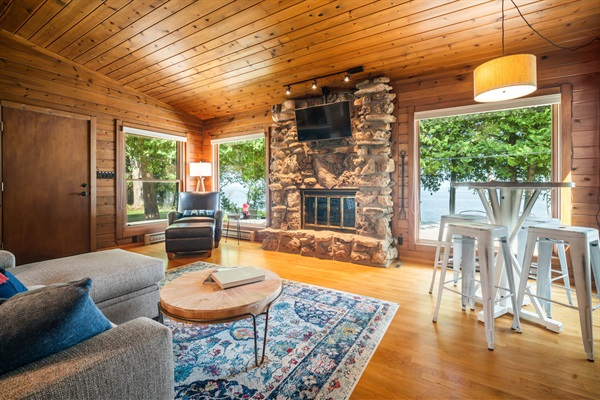 The Door County stone fireplace and views of the bay are on display in the living room.