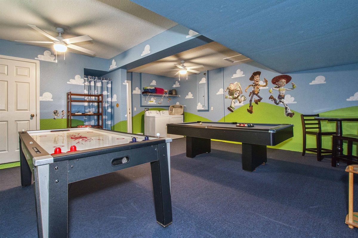 Toy Story game room with laundry facilities for use during your stay.