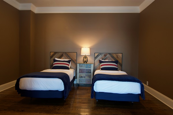 Twin bedroom on 2nd floor is ideal for kids and teens with french doors that can open to family room