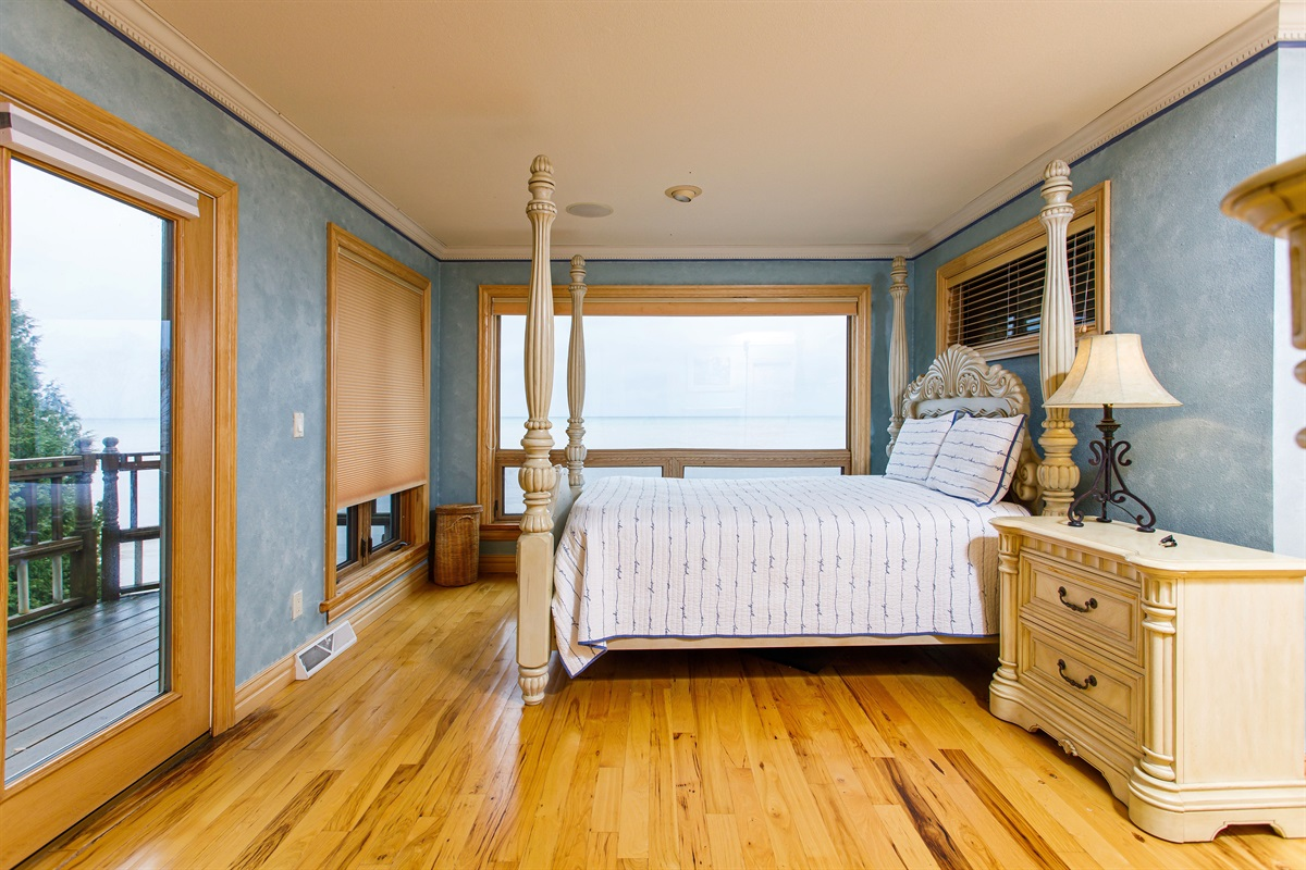 Master bedroom with a queen size bed, private deck, and attached bathroom!