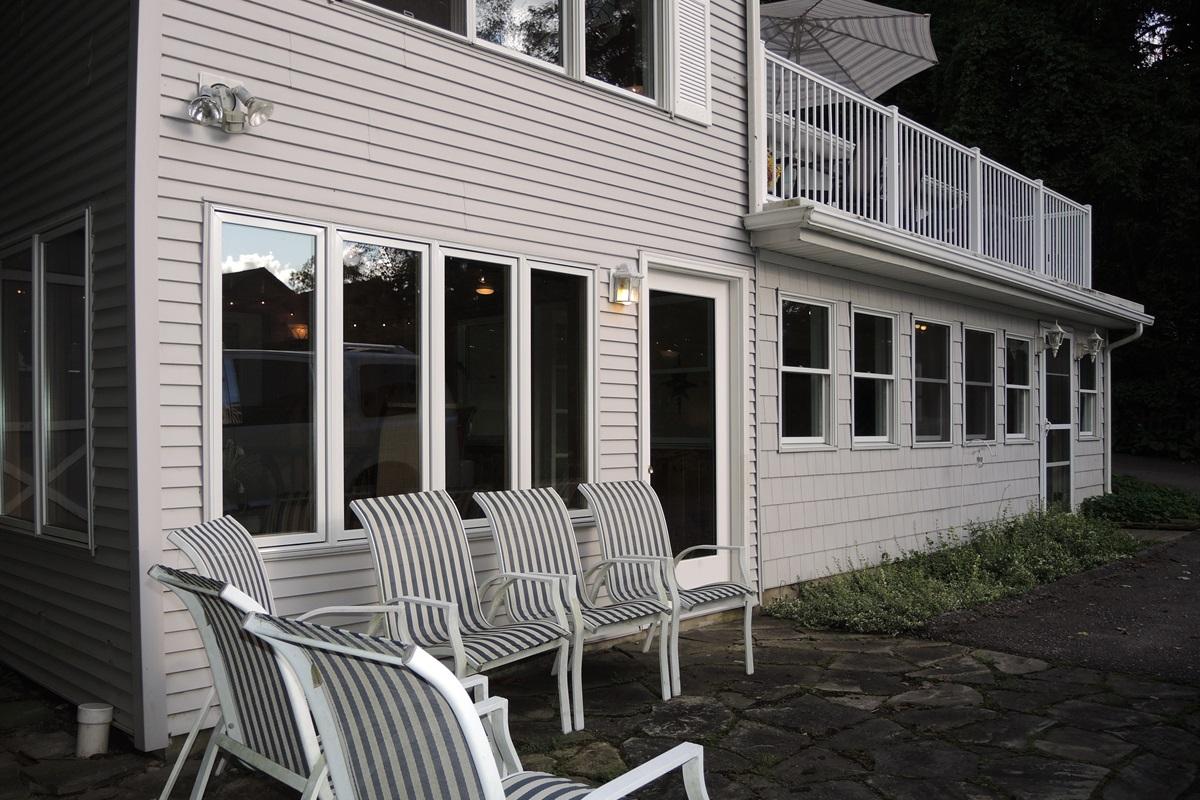 Rear of house with sunroom and roof deck