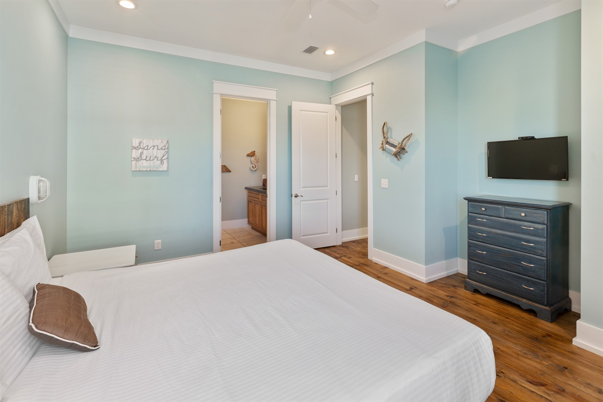 Second floor king suite with private bath, known as the Crab room has a large walk-in closet and views of the pool.