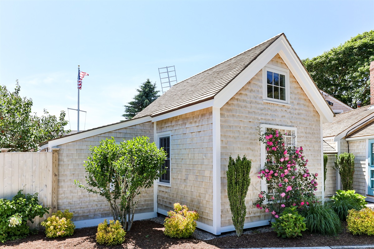 Rear view of the cottage as you enter from the driveway off of Eliphamets Lane. The upper casement window provides for ocean breezes and on a windy day you hear the unmistakable roar of the