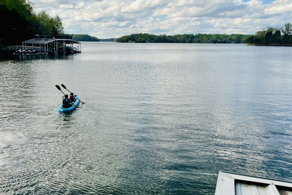 Kayak in our quiet cove or venture into big water. Our two person kayak is included. (View is from our dock)