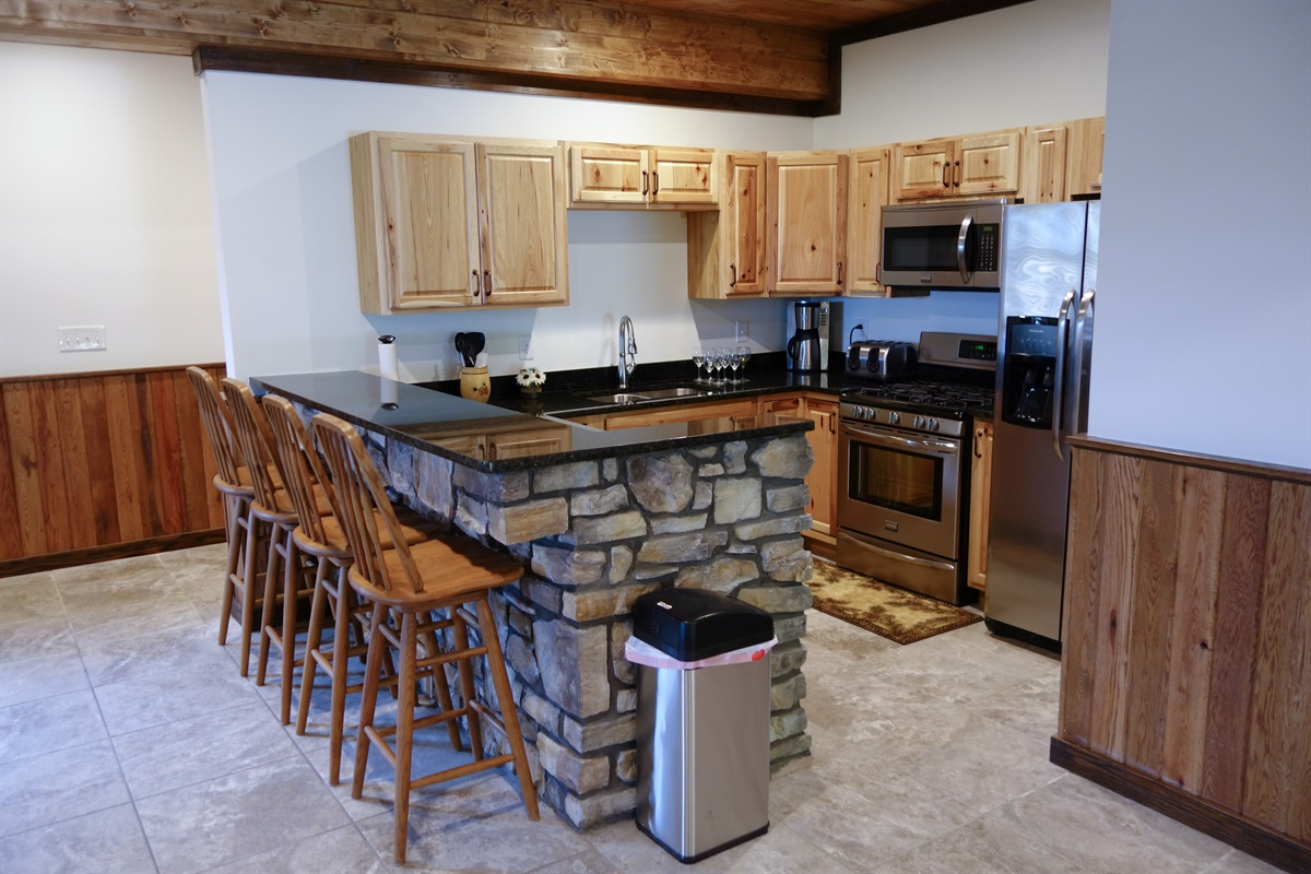 Lower kitchen, fully furnished with fridge, dishwasher, disposal, gas stove, etc