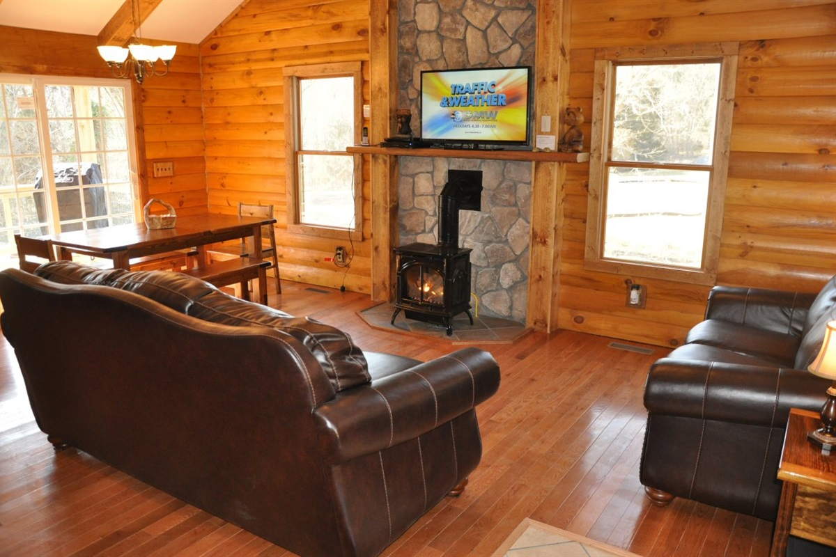 Living room with leather furniture and gas fire