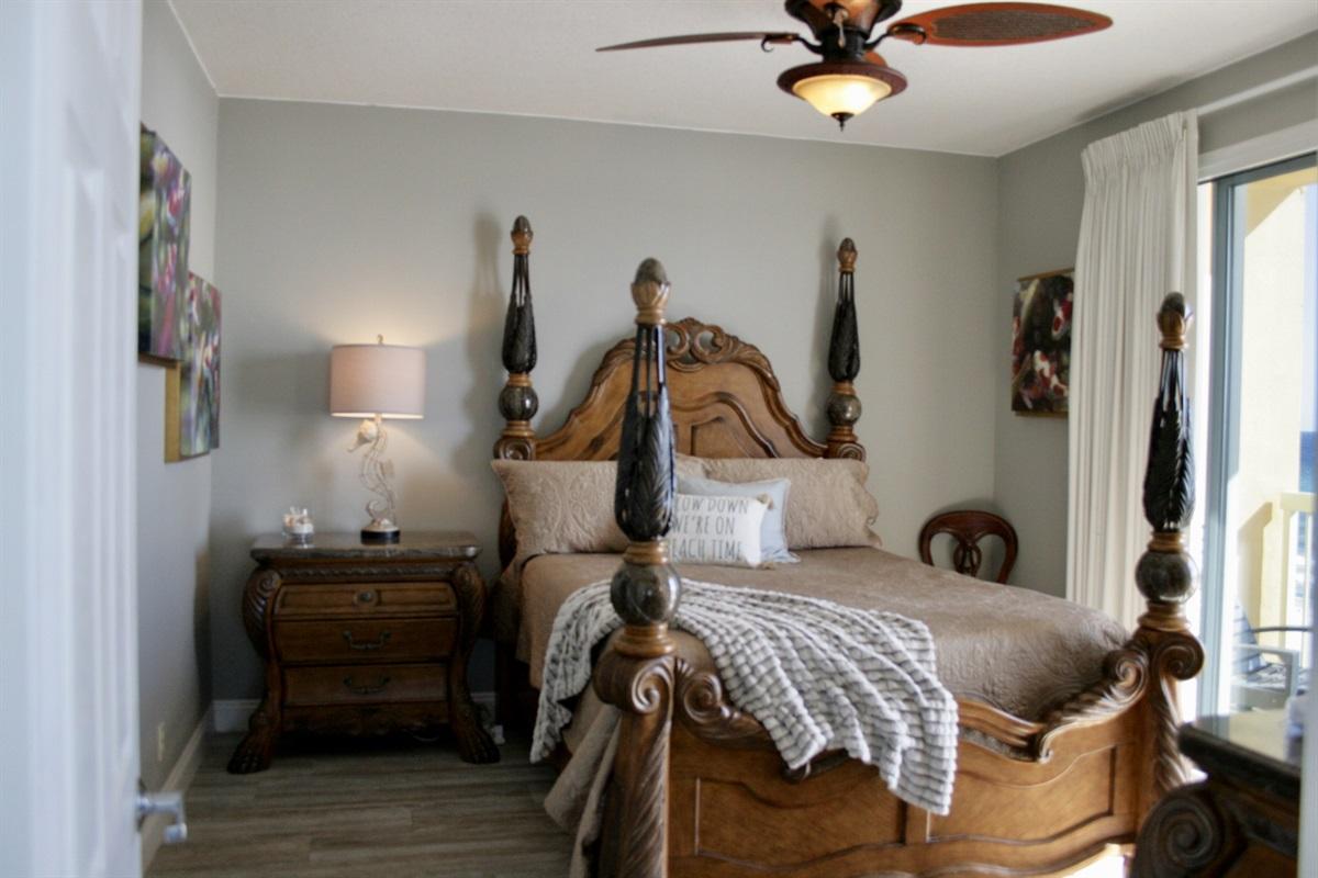 Master Bedroom with queen bed, Ensuite Bathroom, & Balcony access