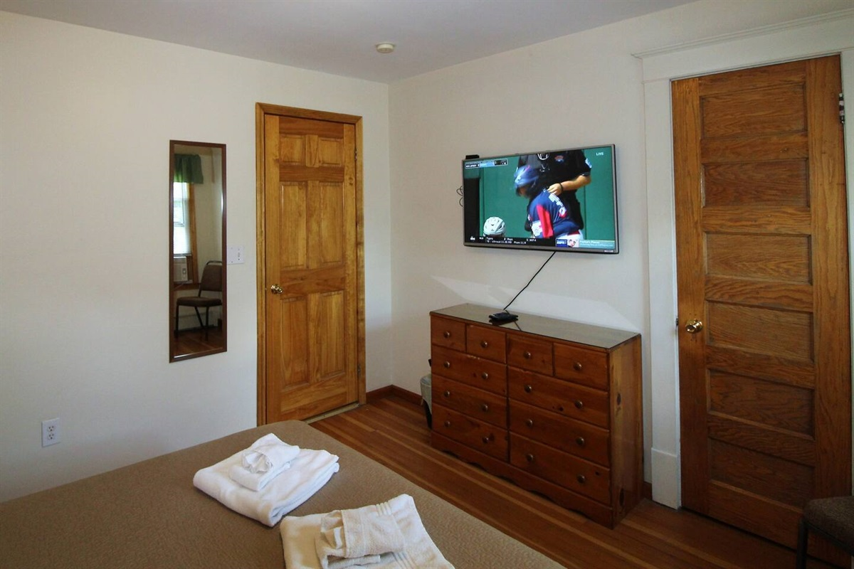 """Bedroom #1 - 43"""" (or larger) flat screen smart Roku TV in every bedroom.  Just bring your streaming apps and never miss any of your favorite programming."""