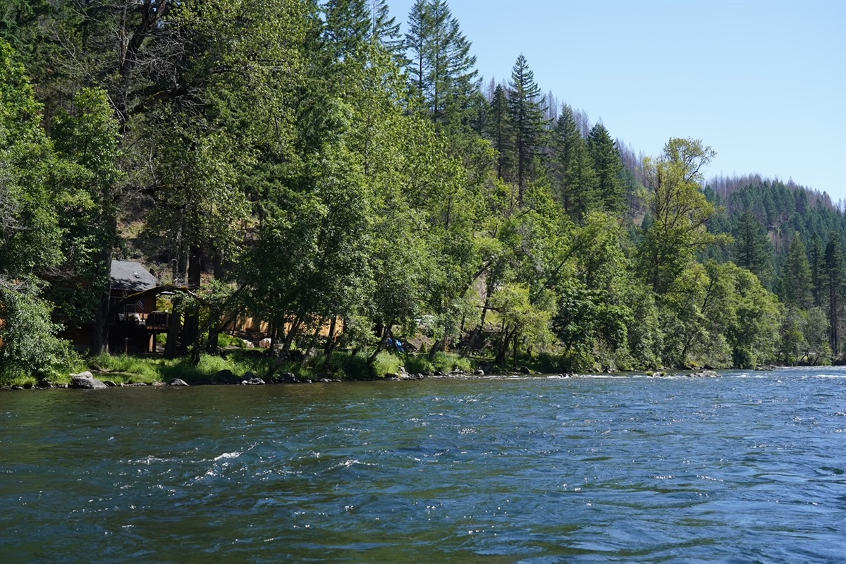 Beautiful view of property and house from across the river.