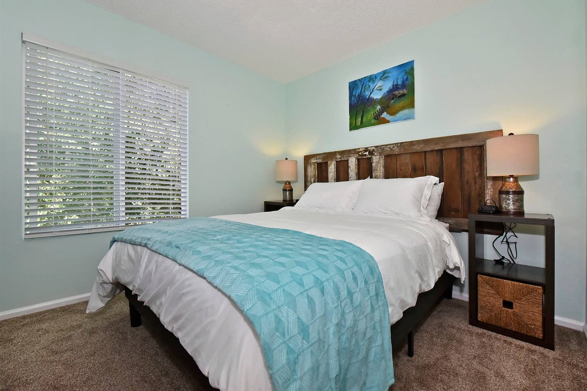 That's a genuine,  reclaimed Colorado barn door as the headboard in the second bedroom!  The painting above the bed has a barn with a missing door.   Is it the same door?