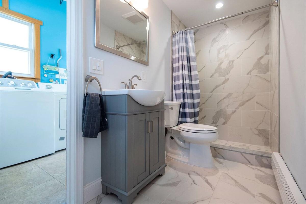 1st Floor: Newly gut renovated bathroom.  Laundry room.