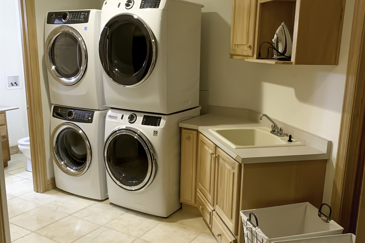 Large laundry room with 2 new washer/dryer and utility sink. Come back from vacation with clean clothes! Half bath is attached to laundry room.