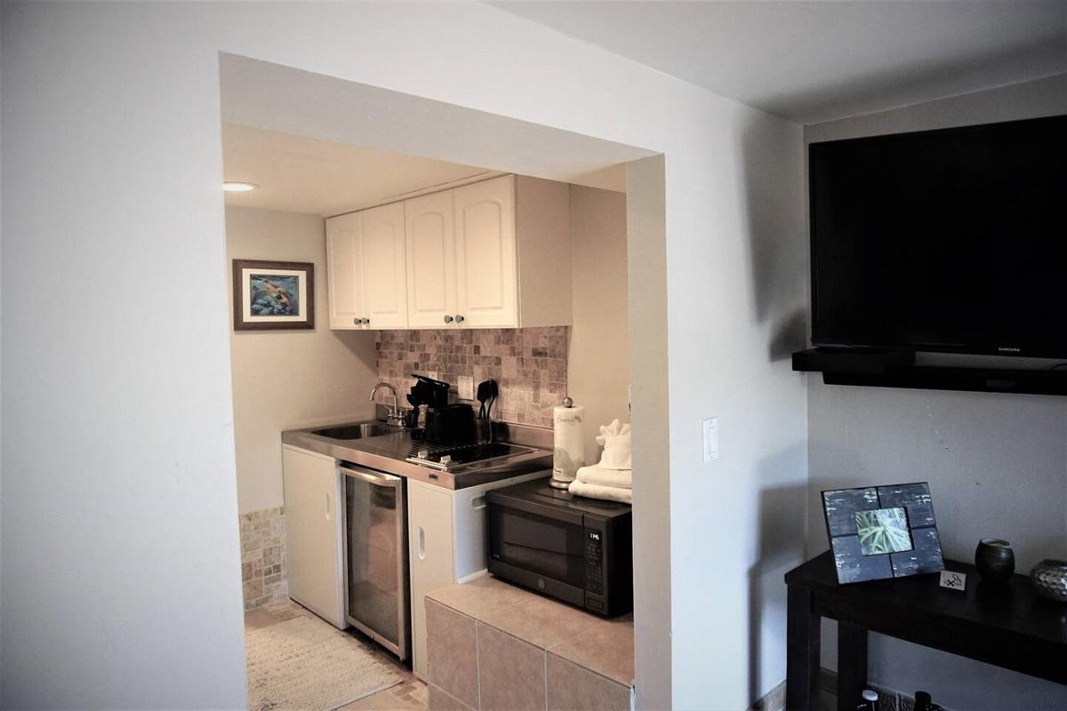 The quaint little kitchenette downstairs provides you with all the cooking essentials you need.