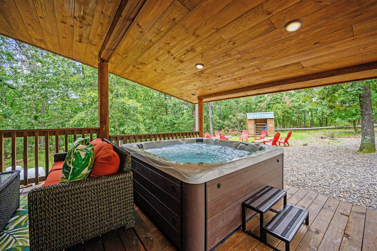 The hot tub  and fire pit are both large enough for the entire group