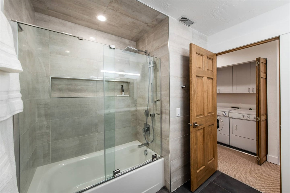 Beautifully remodeled bathroom.  Double vanity, combo tub / shower.  Laundry in closet outside.