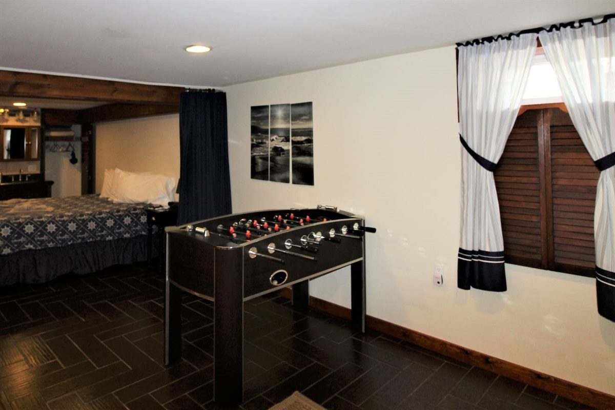 Lower level living area/game room adjacent to bedrooms #1 and #5