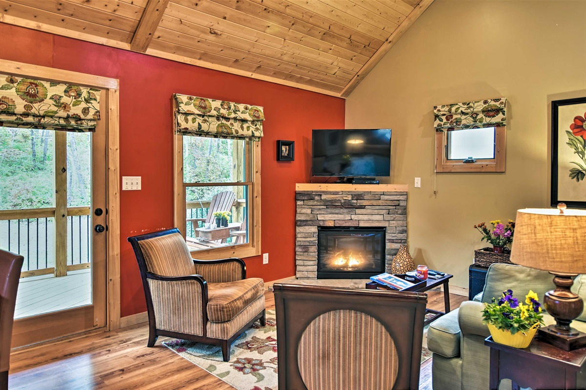 Light the fireplace and watch a show on the flat-screen TV.