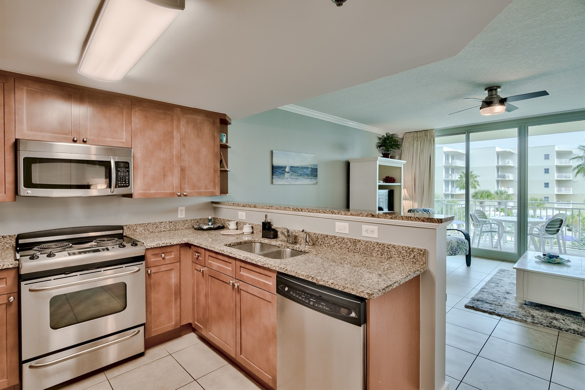 Fully stacked kitchen with stainless steel appliances