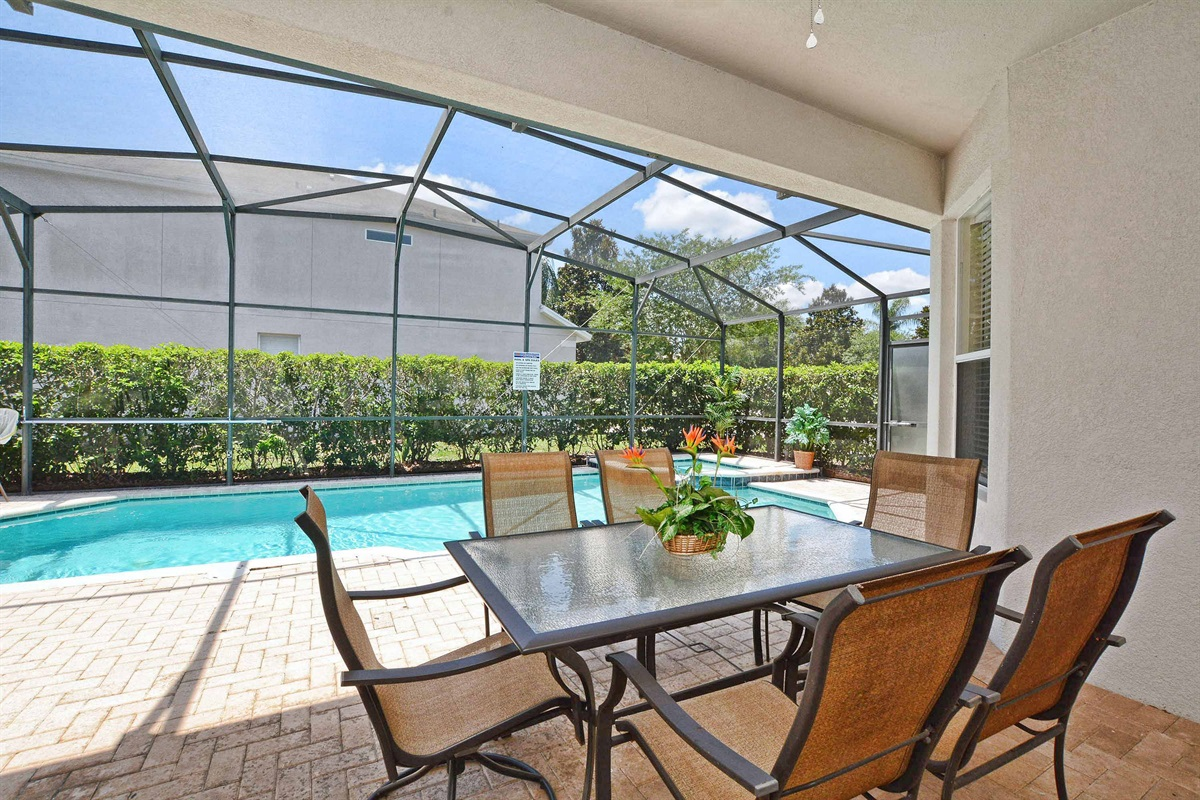 Covered lanai with ceiling fan is shaded all day due to the south facing pool.