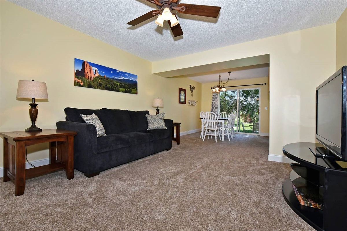 After a long day of hiking and touring, relax in this open concept living room and watch a movie on the smart tv.