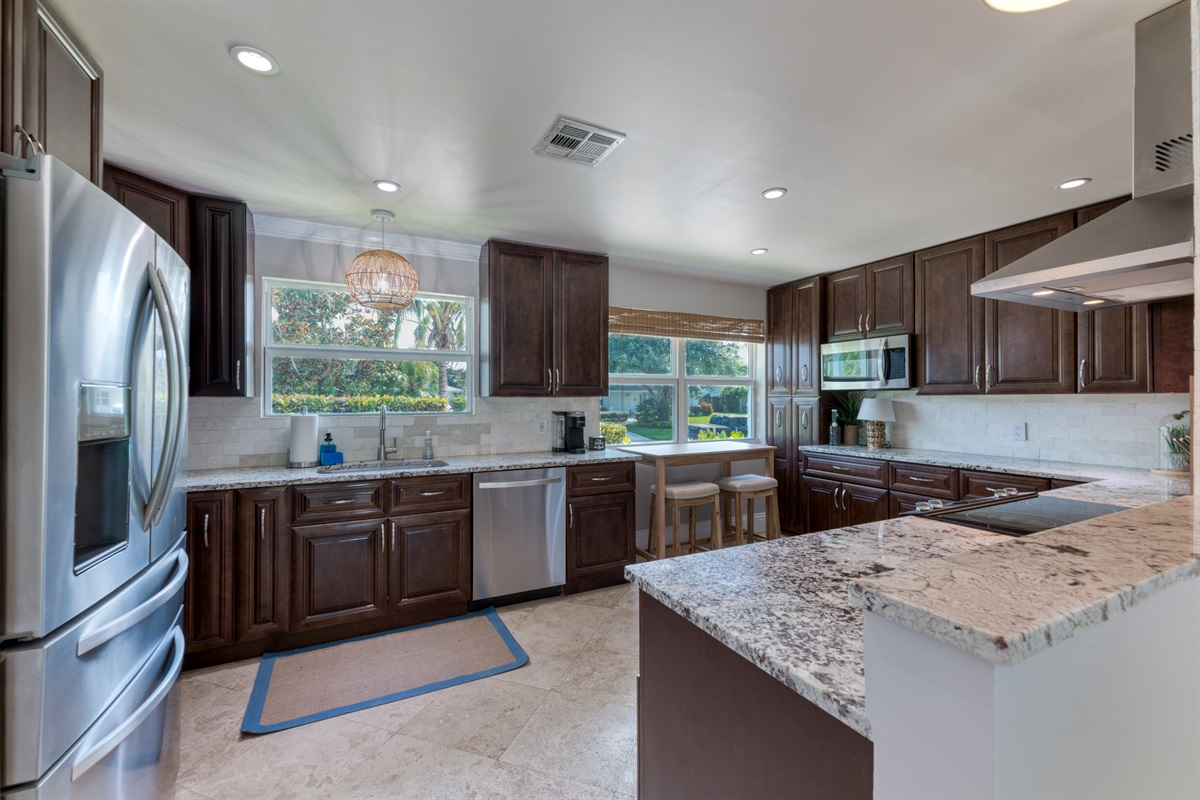 Our kitchen is a Chef's dream! Stainless steel appliances, double door fridge, dark rich wood cabinets and elegant marble counter tops. 2 Seater breakfast nook with views of the front of the house.