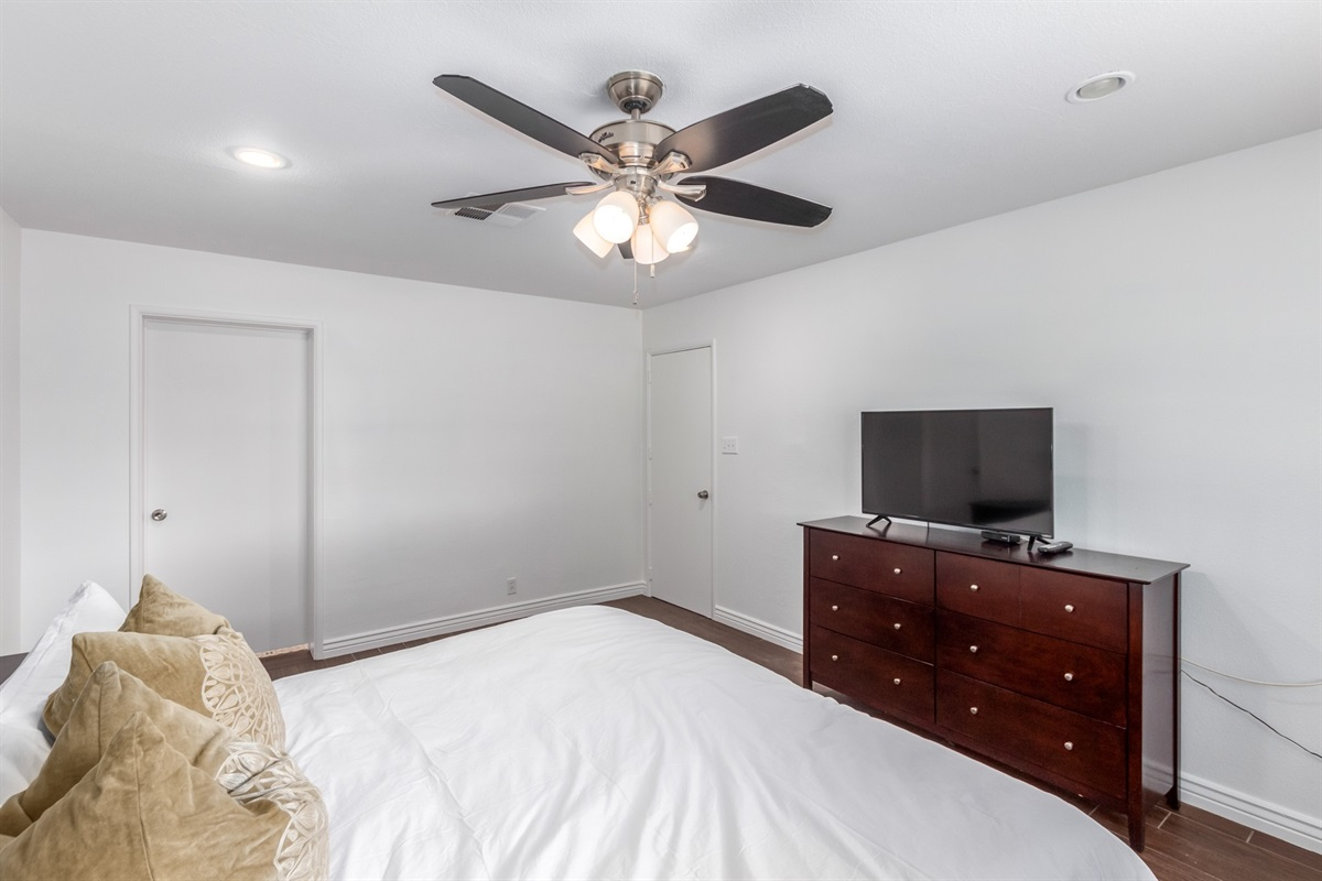 king bed with en suite bathroom